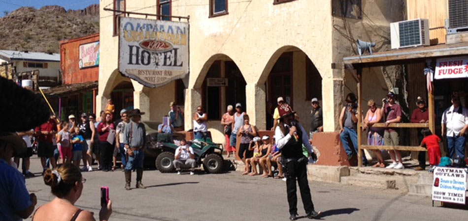 Ghost Town Cowboy shootout at Oatman Hotel with people watching the show