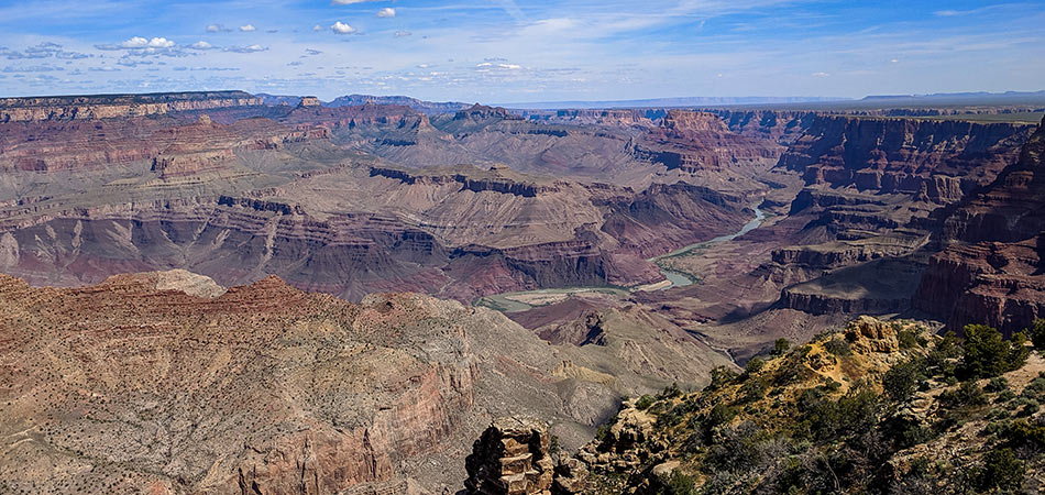 Grand Canyon South Rim overlooking the Colorado River on a blue sky day