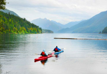 Olympic and Vancouver lake with people kayaking thumbnail